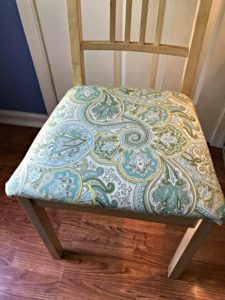 It only takes about 15 minutes to recover a chair cushion.  What a quick way to improve the look of your furniture without spending a lot of money!
