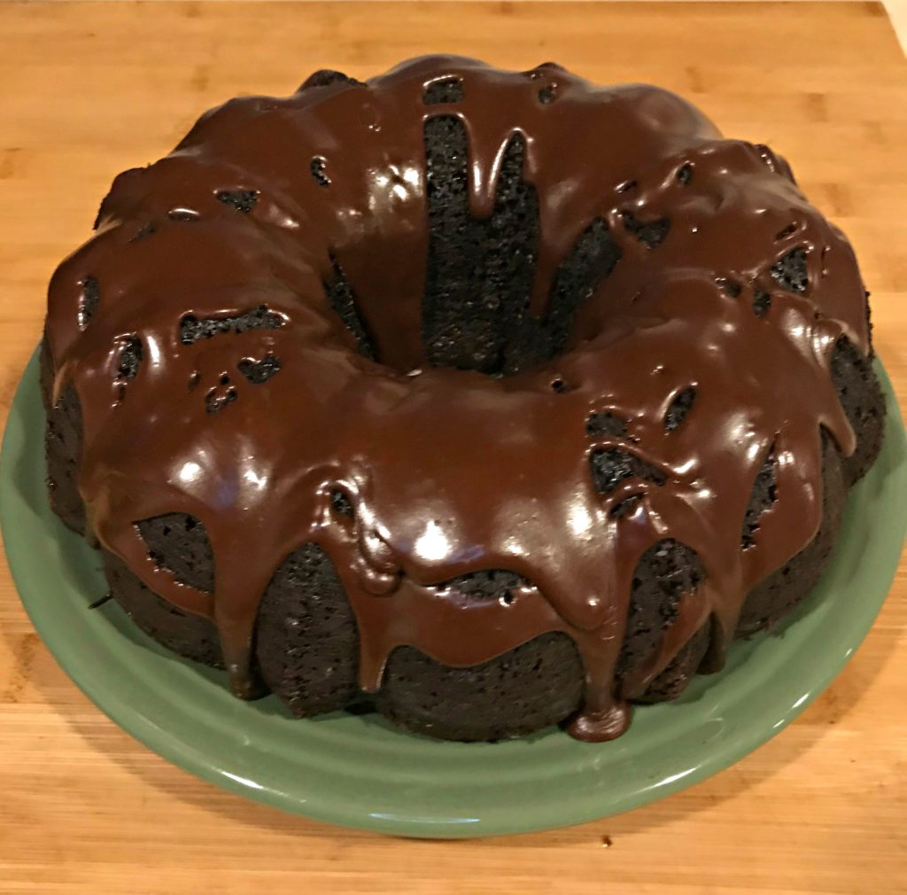 This Sinfully Rich Chocolate Cake can be made into a layer cake for birthdays, but with how rich it is, we prefer it without frosting and just a chocolate glaze drizzled across the top.  The addition of strong black coffee to both the cake batter and the glaze intensify the richness of the chocolate and leave just a light perfume of coffee behind.